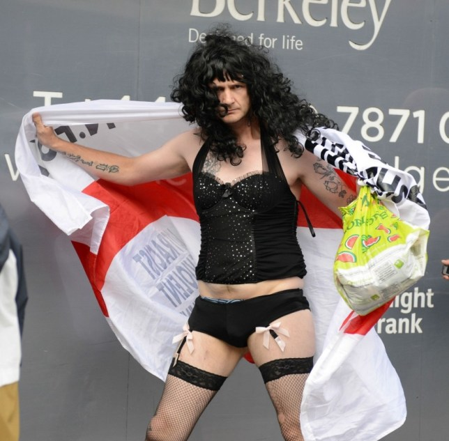 Mandatory Credit: Photo by REX/Tony Kershaw (3004409g)  EDL protester in drag  English Defence League (EDL) march in London, Britain - 07 Sep 2013