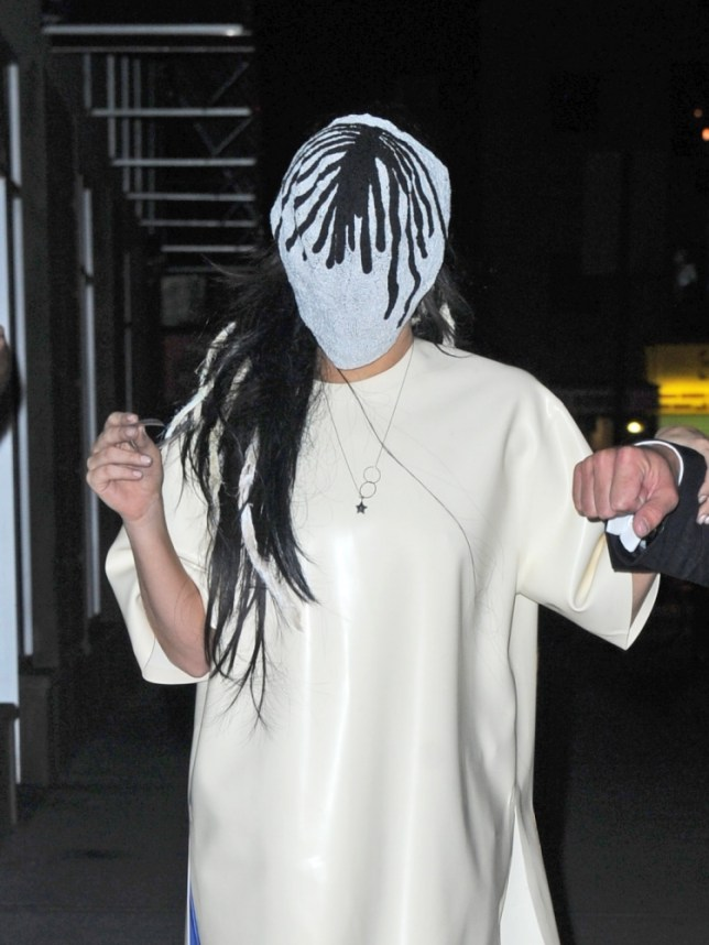 Lady Gaga steps out into the night in Manhattan with a mask over her face and super high heeled boots.  She gets a helping hand from her security. <P> Pictured: Lady Gaga <P><B>Ref: SPL607231  070913  </B><BR/> Picture by: Splash News<BR/> </P><P> <B>Splash News and Pictures</B><BR/> Los Angeles: 310-821-2666<BR/> New York: 212-619-2666<BR/> London: 870-934-2666<BR/> photodesk@splashnews.com<BR/> </P>