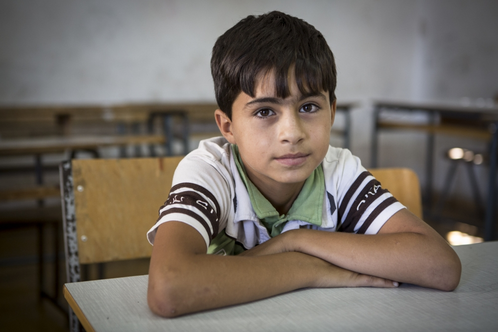 Majed*, 13, at a Save the Children supported school for Syrian refugees in Tripoli, Lebanon. Thousands of children and their families continue to stream into neighbouring countries. Most of those who   ve escaped are living in makeshift shelters, unsuitable buildings or in overcrowded camps, amid growing shortages of food, medicine and water. Save the Children is helping children recover from their experiences within Syria and across the region, to make sure they can access education and to ensure that families have the basic necessities they need to survive     including healthcare, warm clothes, nutritious food and shelter materials.