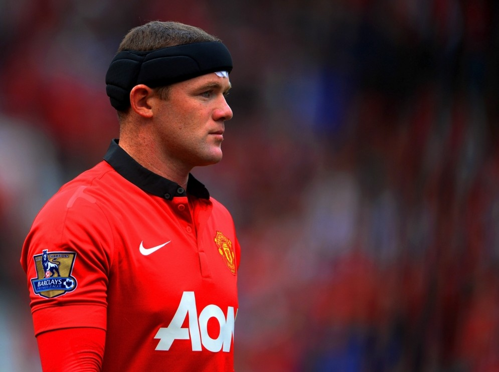 MANCHESTER, ENGLAND - SEPTEMBER 14:  Wayne Rooney of Manchester United wears protective headwear during the Barclays Premier League match between Manchester United and Crystal Palace at Old Trafford on September 14, 2013 in Manchester, England.  (Photo by Michael Regan/Getty Images)