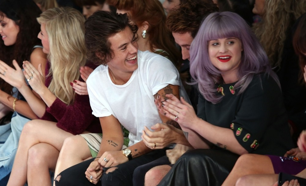 Harry Styles chuckles away at London Fashion Week on front row with Kelly Osbourne and Nick Grimshaw