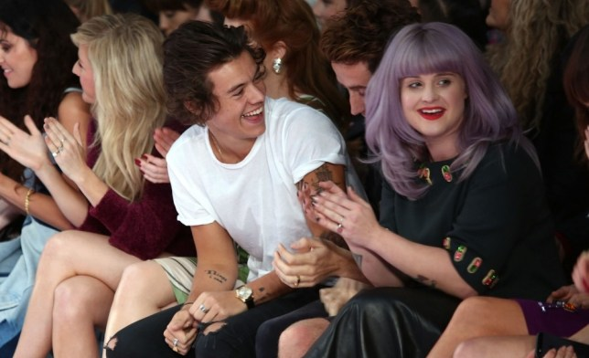 LONDON, ENGLAND - SEPTEMBER 14:  Harry Styles, Nick Grimshaw (obscured) and Kelly Osbourne attends the House Of Holland show during London Fashion Week SS14 at  on September 14, 2013 in London, England.  (Photo by Tim P. Whitby/Getty Images)