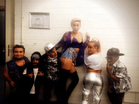 Miley Cyrus performs and twerks with a band of dwarves on German TV