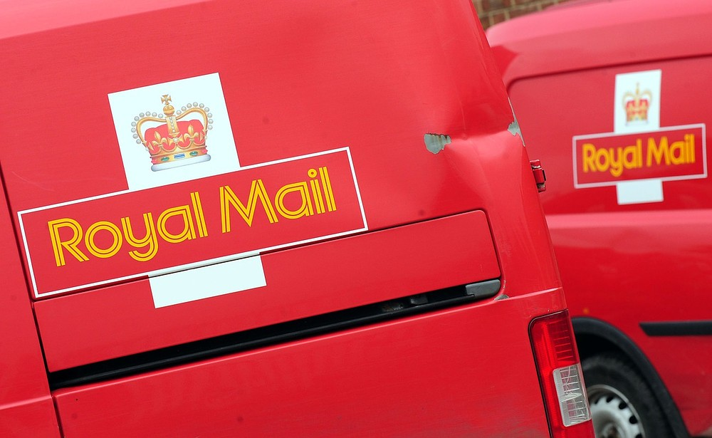 Embargoed to 0001 Tuesday July 30. File photo dated 21/05/13 of Royal Mail vans as Royal Mail staff will be automatically enrolled into an employee share scheme under the Government's plans to privatise the postal company, ministers announced. PA Wire/Press Association Images