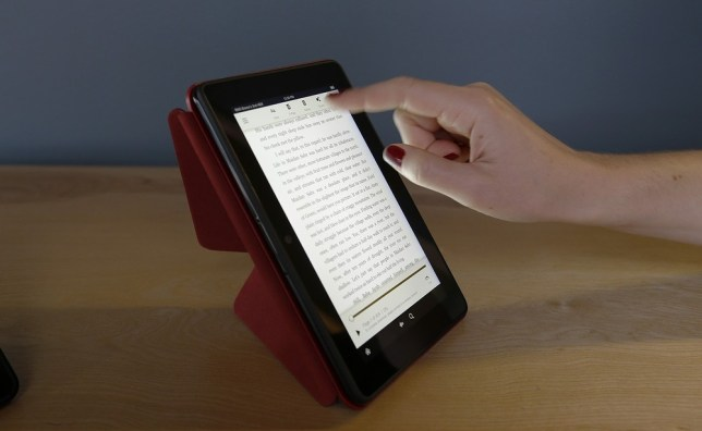 "The 7-inch Amazon Kindle HDX, is shown on the optional folding ""Origami"" stand that also protects the screen when not in use, Tuesday, Sept. 24, 2013, in Seattle. Amazon has refreshed its line-up of tablets with two new HDX devices, which are significantly faster and lighter than the previous generation. AP"