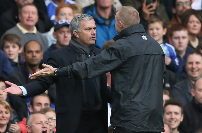 Jose Mourinho and fourth official Trevor Kettle clash at Stamford Bridge yesterday (Picture: AP)