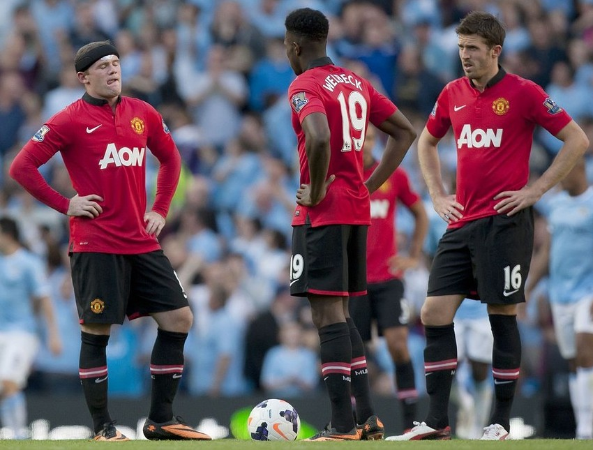 Wayne Rooney, Danny Welbeck and Michael Carrick contemplate two points dropped (Picture: AP)
