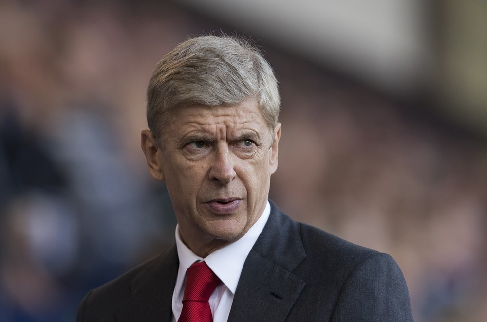 Arsenal's manager Arsene Wenger takes to the touchline before his team's English Premier League soccer match against West Bromwich Albion at The Hawthorns Stadium, West Bromwich, England, Sunday Oct. 6, 2013. AP