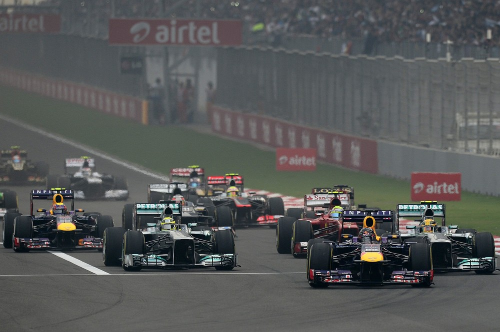 Red Bull driver Sebastian Vettel (2R) of Germany leads the pack during the Formula One Indian Grand Prix 2013 at the Buddh International circuit in Greater Noida, on the outskirts of New Delhi on October 27, 2013. AFP/Getty Images