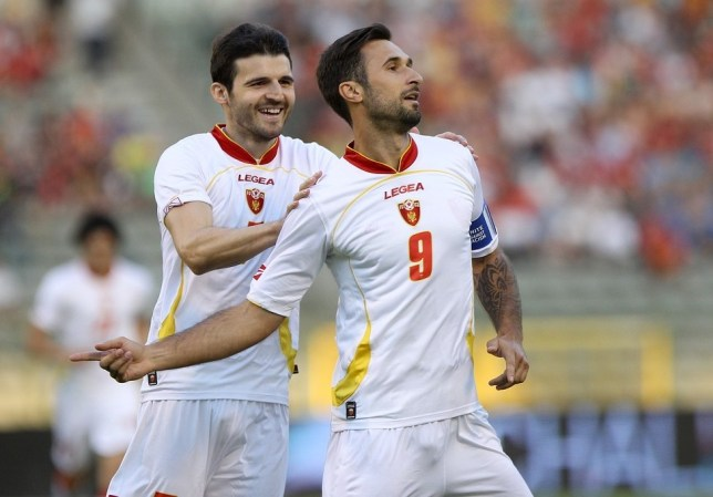 Mirko Vucinic, right, is a national hero in Montenegro (Picture: AFP/Getty Images)