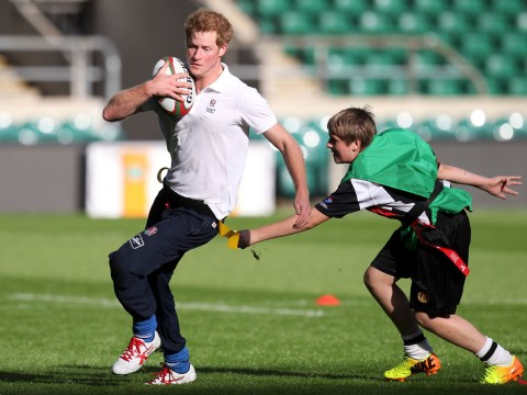 Gallery: Prince Harry joins Jason Robinson in playing rugby against kids