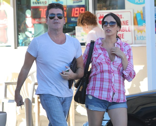 September 29, 2013: Simon Cowell and Lauren Silverman make a pit stop in Cowell's Bentley as they drove all the way to San Diego to see a dog breeder,  CA. Mandatory Credit: INFphoto.com Ref.: infusla-244