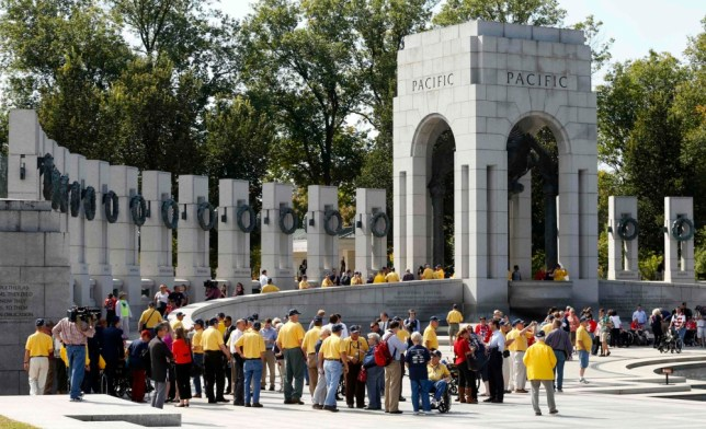 Veterans tour the World War Two Memorial in Washington October 1, 2013. Despite the U.S. government shutdown affecting the site, a barricade was removed to give veterans access to the memorial.  Up to one million federal workers were thrown temporarily out of work on Tuesday as the U.S. government partially shut down for the first time in 17 years in a standoff between President Barack Obama and congressional Republicans over healthcare reforms. REUTERS/Kevin Lamarque  (UNITED STATES - Tags: POLITICS BUSINESS)