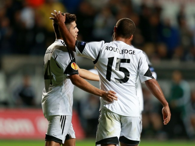 Swansea City's Wayne Routledge (right) celebrates with team-mate Pozuelo after scoring his side's first goal of the game during the UEFA Europa League match at the Liberty Stadium, Swansea. PRESS ASSOCIATION Photo. Picture date: Thursday October 3, 2013. See PA story SOCCER Swansea. Photo credit should read: David Davies/PA Wire