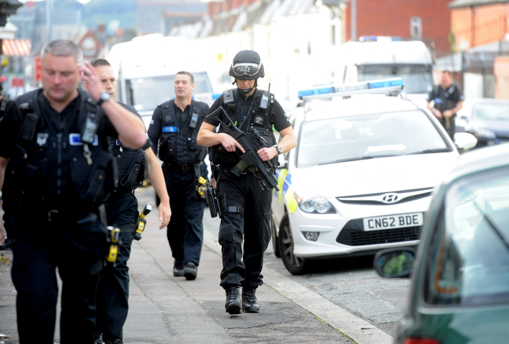 Police arrived at the scene on Monthermer Road early this morning. One eyewitness claimed she helped a policeman who had been attacked (Picture: Huw Evans Picture Agency)