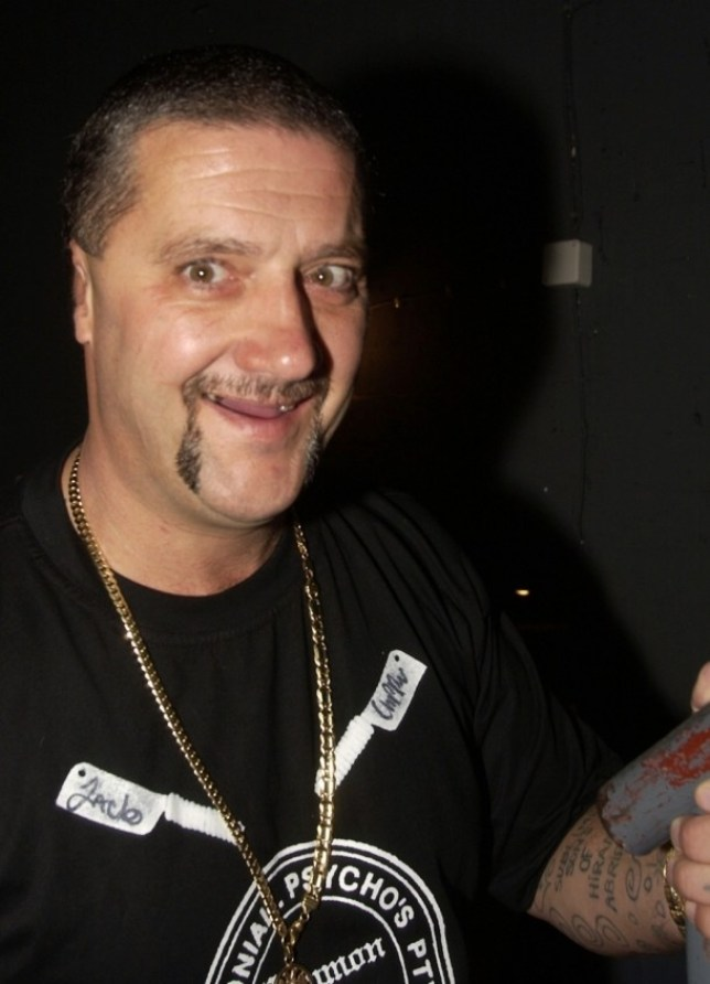 Mark 'Chopper' Read, one of Australia's most notorious criminals, dies from liver cancer aged 58