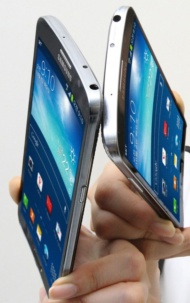 epa03902892 An undated photo provided by the South Korean Yonhap news agency on 09 October 2013 shows Samsung Electronics Co.'s 'Galaxy Round' smartphones with curved, flexible displays. Samsung said on 09 October 2013 it is releasing the new smartphones the following day, the Yonhap news agency reported.  EPA/YONHAP SOUTH KOREA OUT  EDITORIAL USE ONLY
