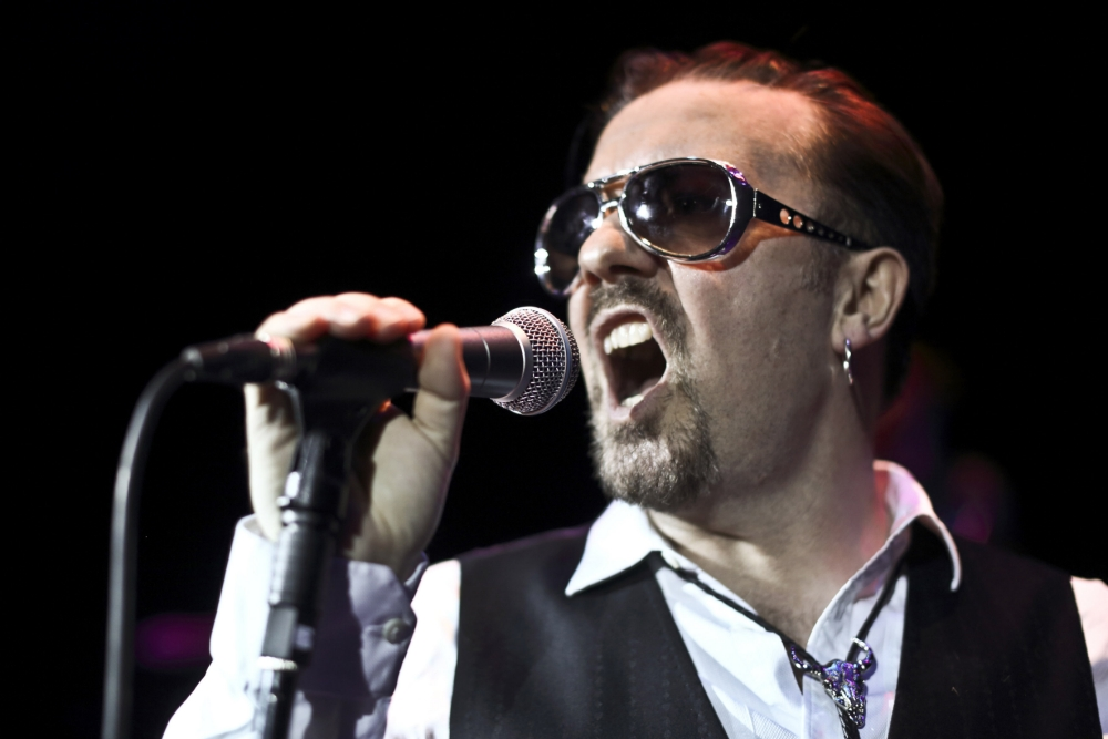 Handout photo issued by KPPR of David Brent on stage at the Bloomsbury Theatre in London as part of his two warm up gigs in London with his band Foregone Conclusion. PRESS ASSOCIATION Photo. Issue date: Monday October 14, 2013. Photo credit should read: Nick Collett/PA Wire NOTE TO EDITORS: This handout photo may only be used in for editorial reporting purposes for the contemporaneous illustration of events, things or the people in the image or facts mentioned in the caption. Reuse of the picture may require further permission from the copyright holder.