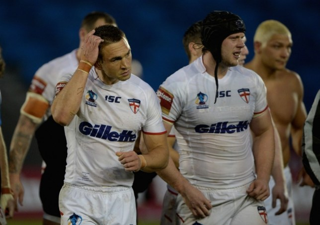 SALFORD, ENGLAND - OCTOBER 19:  England captain Kevin Sinfield and Chris Hill leave the field after losing the International match between England and Italy at Salford City Stadium on October 19, 2013 in Salford, England.  (Photo by Gareth Copley/Getty Images)