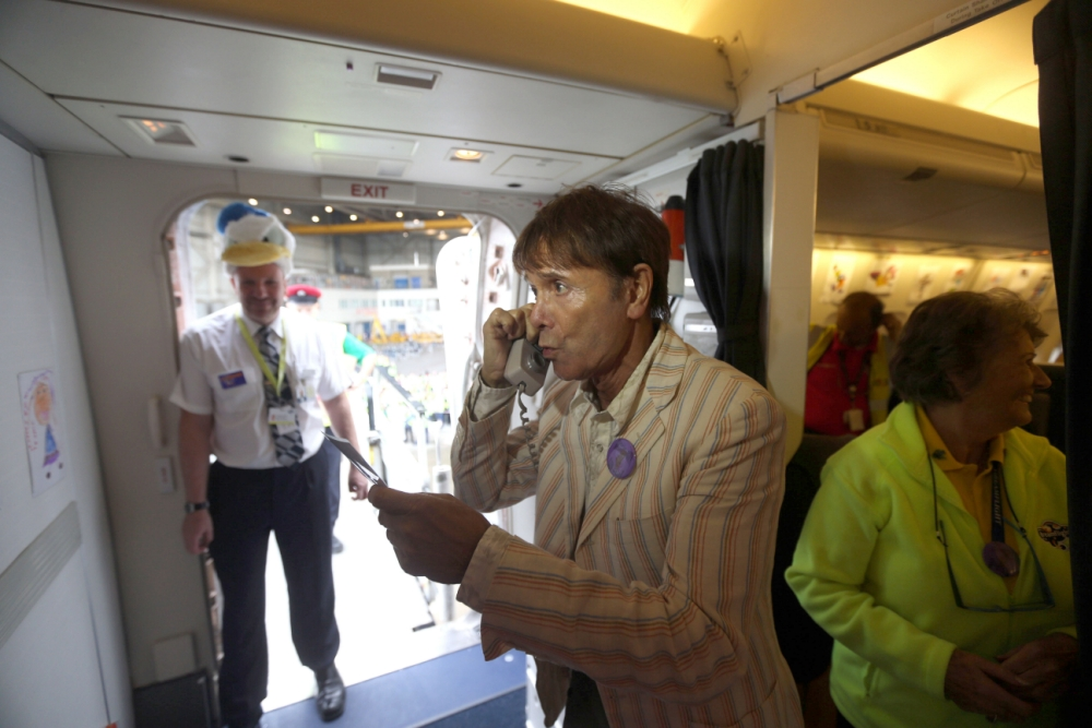 Sir Cliff Richard serenades sick children on board flight of a lifetime to Florida