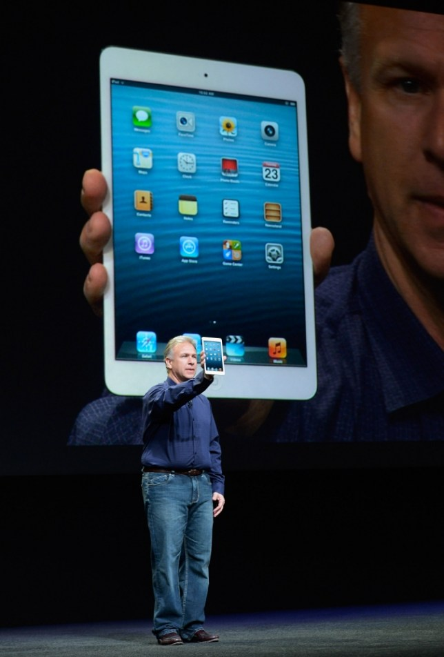 SAN JOSE, CA - OCTOBER 23:  Apple Senior Vice President of Worldwide product marketing Phil Schiller announces the new iPad Mini during an Apple special event at the historic California Theater on October 23, 2012 in San Jose, California. Apple introduced the new iPad mini at the event, Apple's smaller 7.9 inch version of the iPad tablet.  (Photo by Kevork Djansezian/Getty Images)