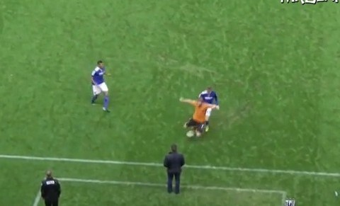 Oldham manager Lee Johnson taken out by a tackle from Wolves' James Henry – video