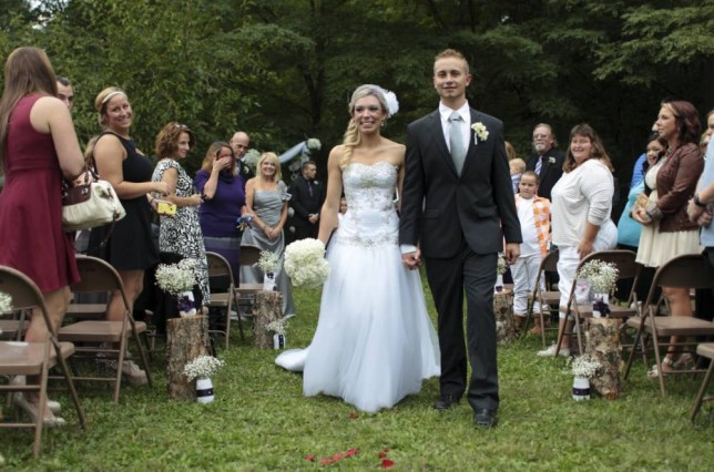 Chelsea Clair and Kyle Froelich walk down the aisle four years after they first met (Picture: AP/The Indianapolis Star/Robert Scheer)