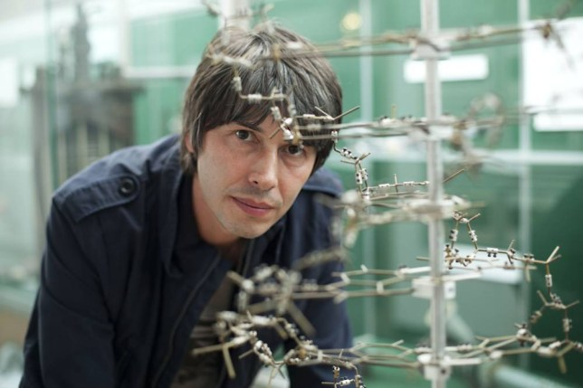 Programme Name: Science Britannica - TX: n/a - Episode: n/a (No. 2) - Embargoed for publication until: n/a - Picture Shows: Professor Brian Cox with a with copy of Crick and Watsons original model of the structure of DNA. Brian Cox - (C) BBC - Photographer: Leili Farzaneh