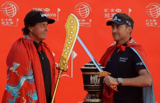 Golfers (L-R) Phil Mickelson of the US and defending WGCHSBC Champion Ian Poulter of England attend the photo call for the WGC-HSBC Champions tournament on the historic Bund in Shanghai on October 29, 2013. The WGC-HSBC Champions will return to Shanghais Sheshan International Golf Club from October 31 to 3 November 3.      AFP PHOTO/Mark RALSTONMARK RALSTON/AFP/Getty Images