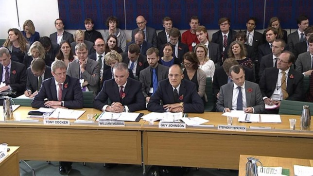 Tony Cocker, chief executive of E.On, William Morris, managing director of SSE, Guy Johnson of Npower and Stephen Fitzpatrick, managing director of Ovo Energy (L-R) are seen attending an Energy and Climate Change Committee hearing at Parliament, in this still image taken from video in London October 29,2013. The bosses of Britain's six major energy suppliers were questioned by MPs on Tuesday over allegations they have abused their power by hiking electricity and gas prices, in a dispute that could affect the next general election.  REUTERS/UK Parliament via REUTERS TV  (BRITAIN- Tags: POLITICS BUSINESS ENERGY)