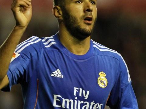 Arsenal boss Arsene Wenger not giving up on Real Madrid hitman Karim Benzema