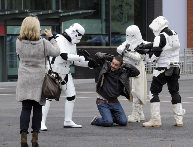 Stormtroopers get tough with one hopeful - maybe he tried to jump the queue? (Picture: Rex)