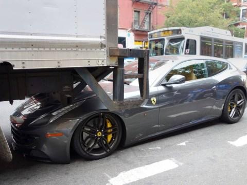 Braking news: Ferrari get squashed by truck then gets parking ticket