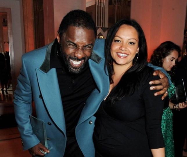 LONDON, ENGLAND - NOVEMBER 05:  Man of othe Year Idris Elba (L) and Naiyana Garth attend the Harper's Bazaar Women of the Year awards at Claridge's Hotel on November 5, 2013 in London, England.  (Photo by David M. Benett/Getty Images)
