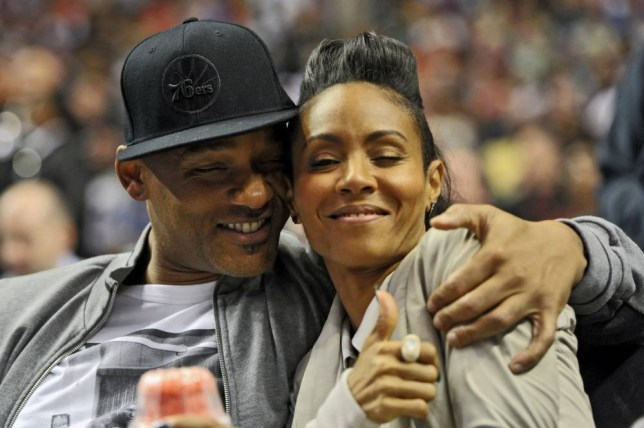 PHILADELPHIA, PA - MARCH 16:  Entertainer Will Smith and his wife Jada Pinkett Smith share a moment on the sideline during the game between the Philadelphia 76ers and Miami Heat at the Wells Fargo Center on March 16, 2012 in Philadelphia, Pennsylvania. The Heat won 84-78. NOTE TO USER: User expressly acknowledges and agrees that, by downloading and or using this photograph, User is consenting to the terms and conditions of the Getty Images License Agreement. (Photo by Drew Hallowell/Getty Images)