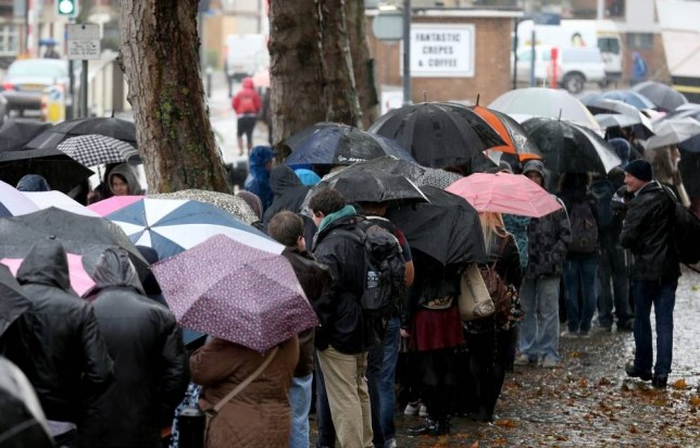 BRISTOL, ENGLAND - NOVEMBER 09:  People queue in the rain outside the Bristol Arnolfini art centre for an open audition for two lead roles in the next Star Wars film on November 9, 2013 in Bristol, England. Production company Lucasfilm has chosen Bristol to start a series of casting sessions across the UK and Ireland for two lead roles in the forthcoming Star Wars: Episode VII.  (Photo by Matt Cardy/Getty Images)