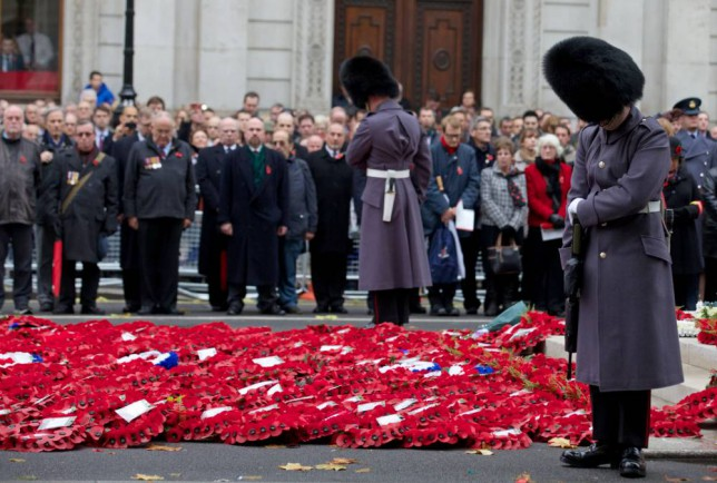 British military personnel, veterans and members of the public, observe a two-minute silence on Armistice Day at the Cenotaph in central London, on November 11, 2013, in memory of Britain's war dead. In the run-up to Armistice Day, many Britons wear a paper red poppy -- symbolising the poppies which grew on French and Belgian battlefields during World War I -- in their lapels.  AFP PHOTO / ANDREW COWIEANDREW COWIE/AFP/Getty Images