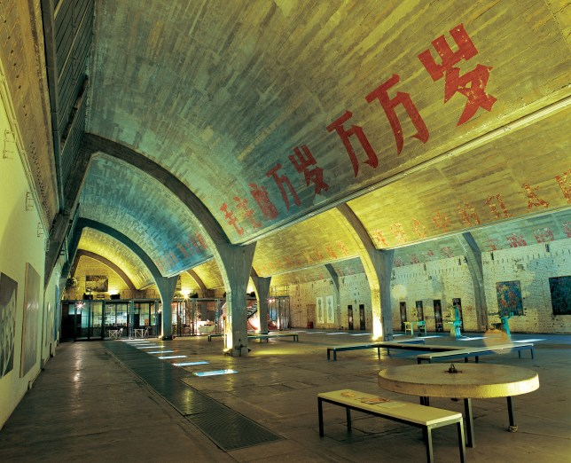 The 798 Space in Beijing is plastered with cultural slogans (Picture: Alamy)