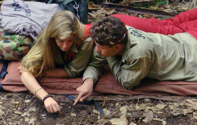 ***EMBARGO NOT TO BE USED BEFORE 21:00 17 Nov 2013 - EDITORIAL USE ONLY - NO MERCHANDISING***  Mandatory Credit: Photo by ITV/REX (3377324an)  Amy Willerton teaches Joey Essex to tell the time using a clock face drawn on the jungle floor  'I'm A Celebrity...Get Me Out Of Here!' TV Programme, Australia - 16 Nov 2013