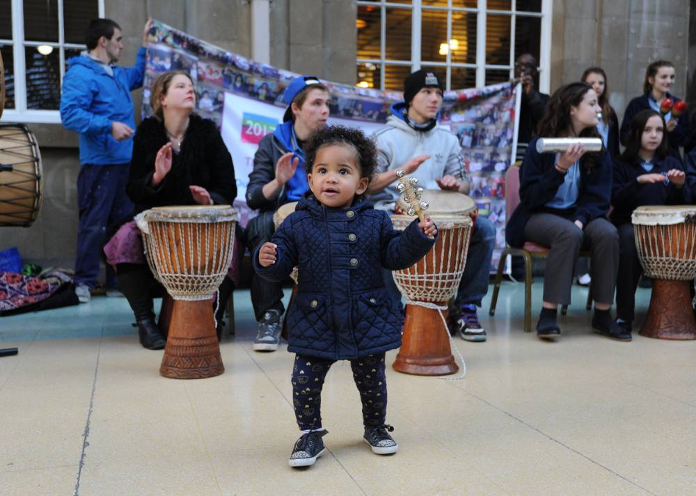 17 month old Tallula-Amai Oware joins in the celebrations in Hull after the city was named as the UK City of Culture 2017. PRESS ASSOCIATION Photo. Picture date: Wednesday November 20, 2013. Hull has been named as the UK City of Culture 2017, seeing off competition from Dundee, Leicester and Swansea Bay. The city will hope to see an economic boost from the accolade which is handed out every four years. See PA story ARTS Culture. Photo credit should read: Anna Gowthorpe/PA Wire