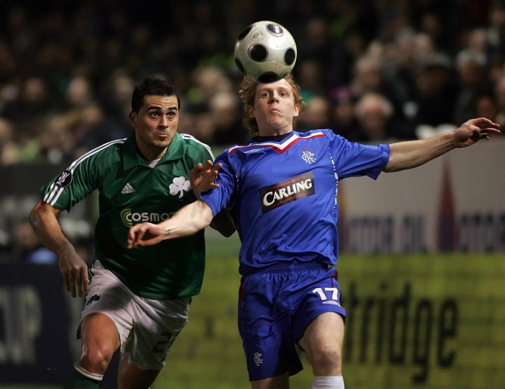 Rangers FC Chris Burke (R) vies with Panathinaikos Athens's Loukas Vintra during their UEFA Cup soccer match in Athens on February 21, 2008. The match ended 1-1.  AFP PHOTO/Louisa Gouliamaki (Photo credit should read LOUISA GOULIAMAKI/AFP/Getty Images)