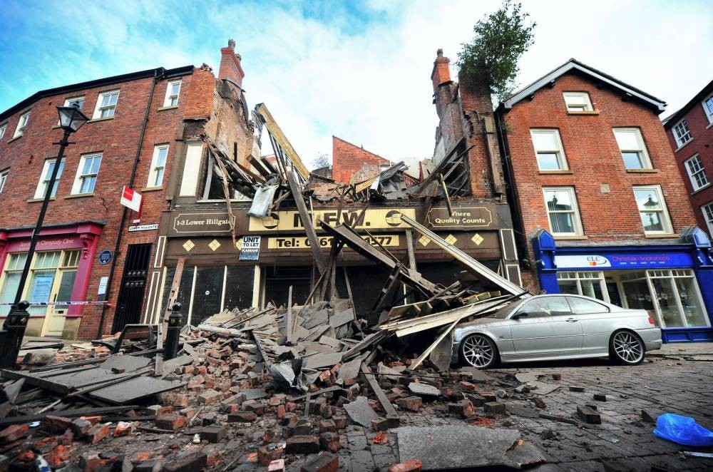 Man's prized BMW crushed as derelict building collapses in Stockport