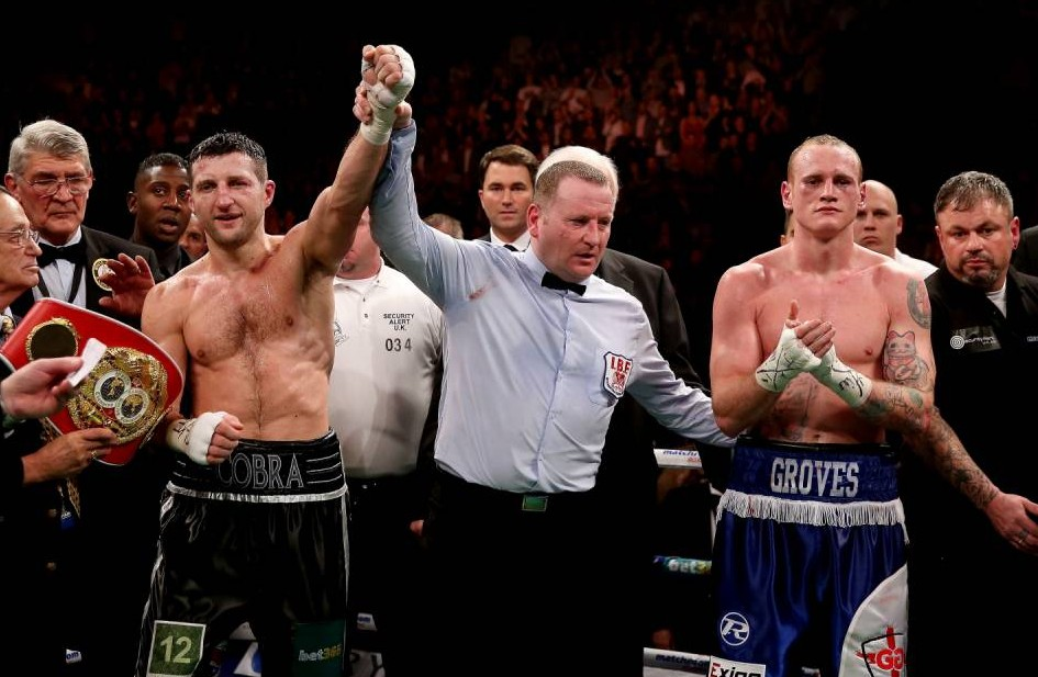 Carl Froch offers rematch to George Groves after retaining title with controversial stoppage