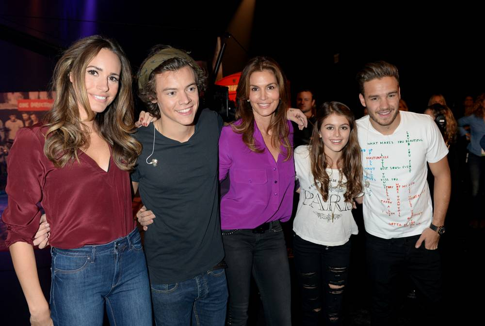 PLAYA VISTA, CA - NOVEMBER 23:  (L-R) Louise Roe, Harry Styles, Cindy Crawford, Kaya Jordan Gerber, and Liam Payne on set during One Direction celebrates 1D Day at YouTube Space LA, a 7-hour livestream event broadcast exclusively on YouTube and Google+. Featuring behind the scenes footage, Guinness world record attempts, and amazing special guests, the global event also marked the premiere of tracks from their new album 'Midnight Memories', set for release November 25th, in Playa Vista, California on November 23, 2013  (Photo by Jeff Kravitz/FilmMagic)