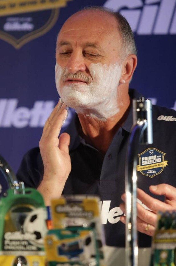 Brazil boss Big Phil Scolari proves he's razor-sharp by shaving at press conference