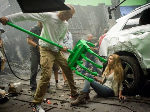 Michael Bay wields giant green claw in new Transformers: Age of Extinction stills