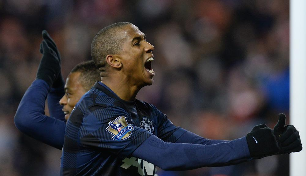 Ashley Young and Patrice Evra send Manchester United storming into Capital One Cup semi-final
