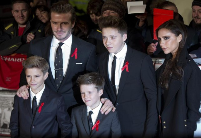 """David Beckham, his wife Victoria, and their children Brooklyn, Cruz and Romeo attend the world premier of the film """"The Class of 92"""" in London December 1, 2013. REUTERS/Neil Hall (BRITAIN - Tags: ENTERTAINMENT SPORT SOCCER) Neil Hall/Reuters"""