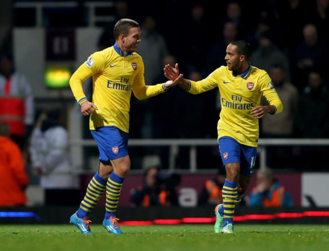 Both Podolski and Walcott showed their goalscoring ability at Upton Park (Picture: Ian Walton/Getty)