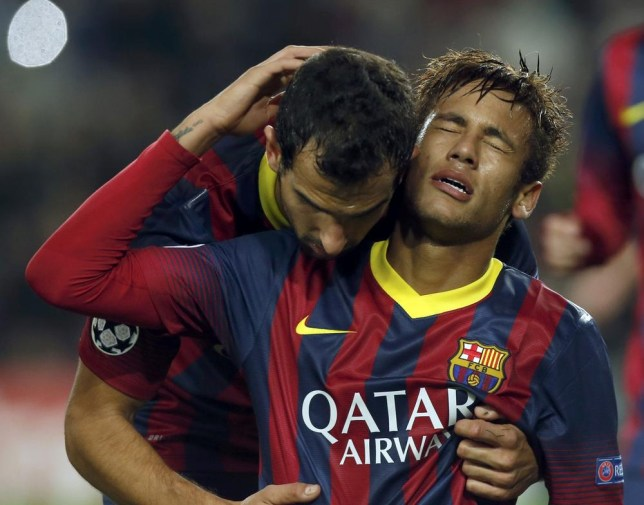 Barcelona's Neymar (R) is congratulated by his team mate Martin Montoya after scoring a goal against Celtic during their Champions League soccer match at Camp Nou stadium in Barcelona December 11, 2013. REUTERS/Albert Gea (SPAIN - Tags: SPORT SOCCER) Albert Gea/Reuters